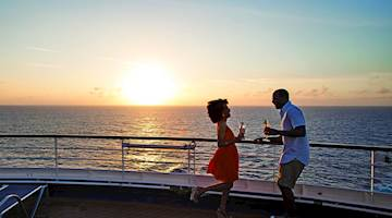 Couple dancing onboard Carnival Cruises