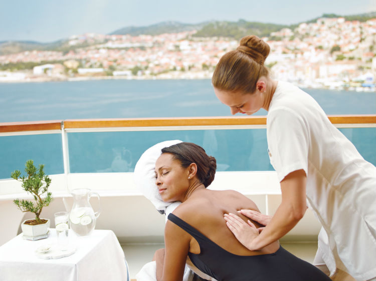 A woman receiving a massage out on deck on a Seabourn Cruise
